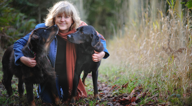 Picture of Leah Erb with two big dogs
